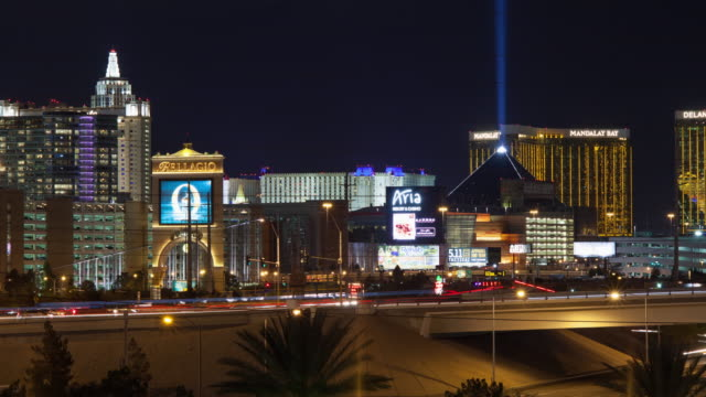 ws t/l view of modern buildings at night, mandalay bay in background / las vegas, nevada, united states  - mandalay bay resort and casino stock videos and b-roll footage