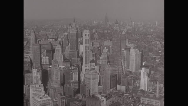 WS AERIAL POV View of modern crowded cityscape of lower Manhattan / New York City, New York State, United States