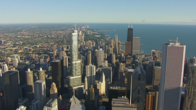 WS AERIAL POV View of modern skyline with Grant Park in Millennium Park / Chicago, Cook County, Illinois, United States