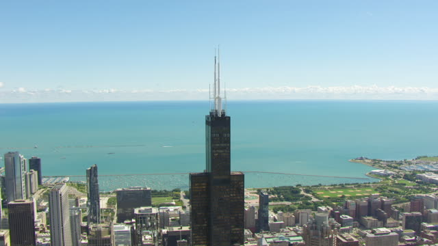 ws aerial pov view of modern skyline with willis tower / chicago, cook county, illinois, united states  - willis tower stock videos and b-roll footage