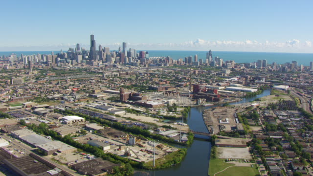 ws aerial pov view of modern skyline with willis tower near chicago river / chicago, cook county, illinois, united states  - industrial district stock videos & royalty-free footage