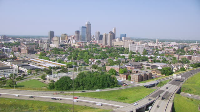 WS AERIAL POV View of modern skyscrapers in downtown Indianapolis with busy highway / Indianapolis, Marion County, Indiana, United States