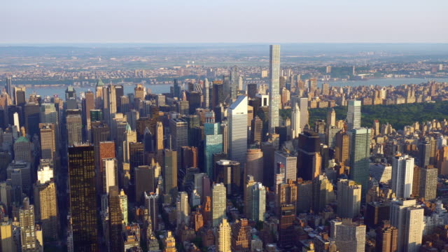 WS AERIAL POV View of modern skyscrapers in downtown / Midtown Manhattan, New York City, New York State, United States