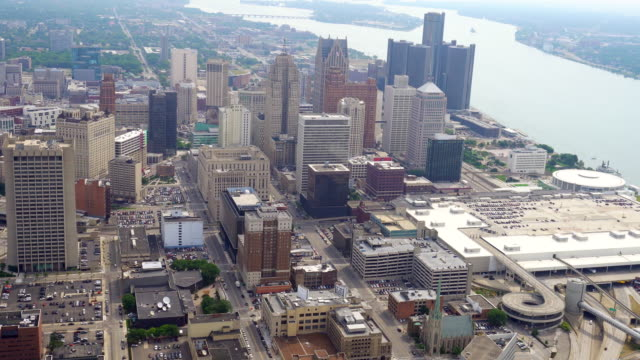 ws aerial pov view of modern skyscrapers in downtown with detroit river in background / downtown detroit, detroit, michigan, united states - detroit michigan stock videos & royalty-free footage