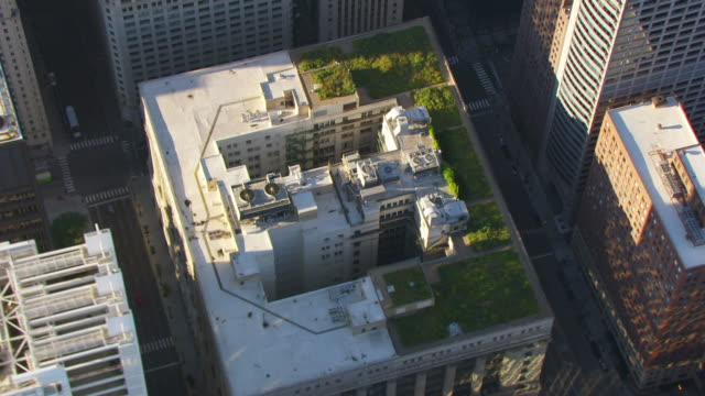 WS AERIAL POV View of modern skyscrapers with Chicago City Hall Green Roof / Chicago, Cook County, Illinois, United States