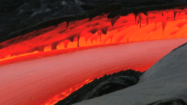 cu view of molten lava flow / kalapana, hawaii, usa - lava video stock e b–roll