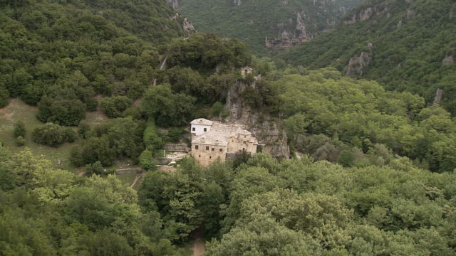 WS AERIAL View of monastery in middle of Vikos Gorge and stream / Epiros, Thessalia, Greece