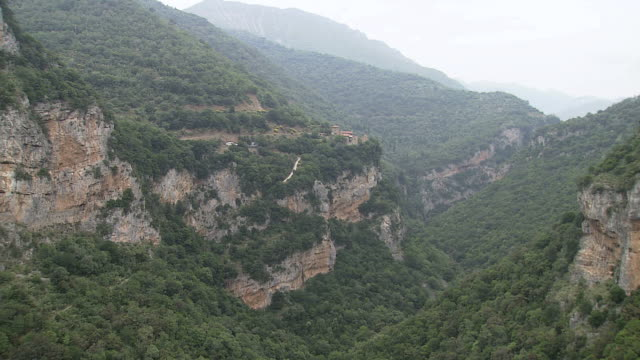 WS AERIAL View of monastery on Lousios river cliff / Lousios river,  Peloponissos, Greece