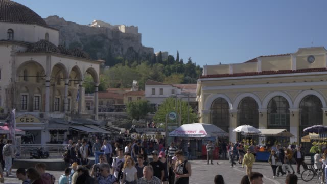 view of monastiraki square and the acropolis visible in background, monastiraki district, athens, greece, europe - athens greece stock videos & royalty-free footage