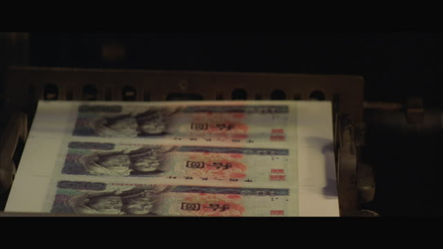 cu pan view of money printing machine printing chinese yuen currency - chinese currency stock videos & royalty-free footage