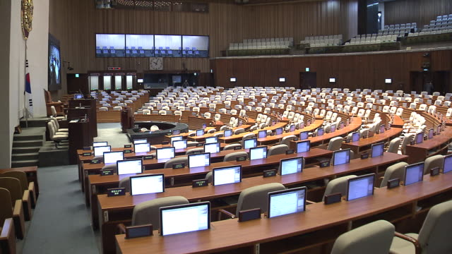 view of monitors being moved down in the national assembly of south korea - chairs in a row stock videos & royalty-free footage