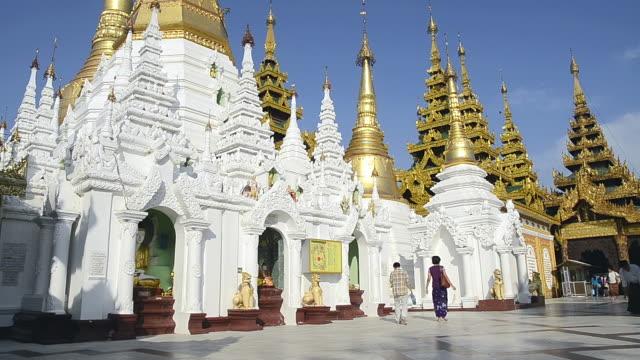 WS LA View of Monk and local people walking around famous Shwedagon Pagoda / Yangon, Yangon Division, Myanmar