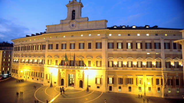 WS T/L View of Montecitorio Italian Parliament from duks till dawn / Rome, Lazio, Italy