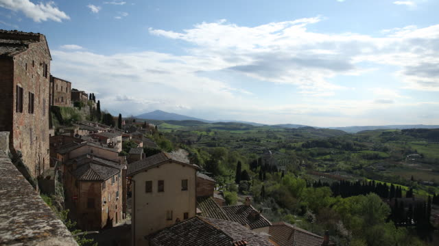 view of montepulciano medieval town from hillside - toscana video stock e b–roll
