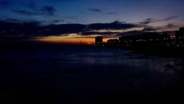 view of montevideo's coastline, after sunset, blue hour, uruguay - montevideo stock-videos und b-roll-filmmaterial