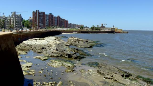 view of montevideo's coastline, ciudad vieja neighbourhood, old fortress wall, uruguay - sedative stock videos & royalty-free footage
