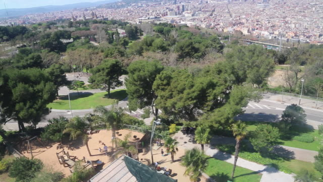 view of  montjuic hill and the city of barcelona, from the cable car. - overhead cable car stock videos & royalty-free footage