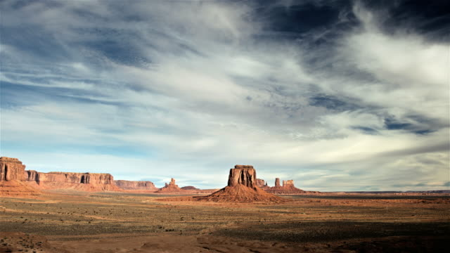 ws t/l pan view of monument valley and clouds moving over  / monument valley tribal park, arizona, united states - monument valley stock-videos und b-roll-filmmaterial