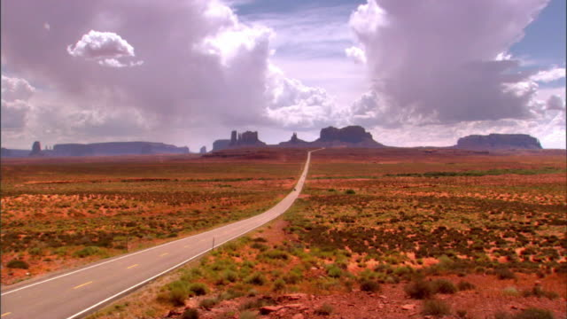 ZO view of Monument Valley looking south on US Route 163 from north of the Arizona Utah State line / Mexican Hat, Utah, USA