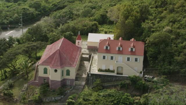 ws aerial pov view of moravian church / coral bay, saint john, us virgin islands, united states - st. john virgin islands stock videos & royalty-free footage