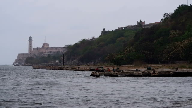 View of Morro Castle and rocky coastline from ferry boat, Havana, Cuba