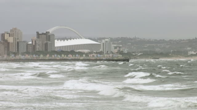 ws view of mosses machida stadium across ocean / durban, kwazulu natal, south africa - durban stock videos and b-roll footage