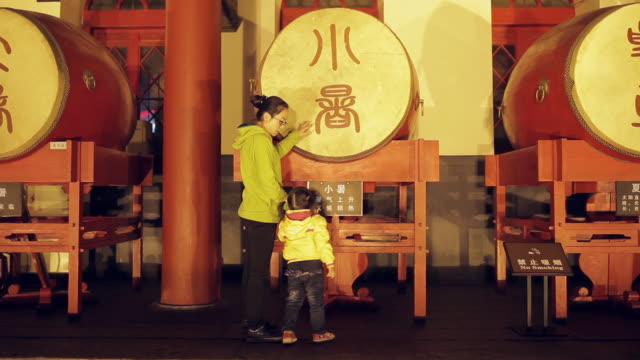 MS View of mother and daughter talking in Drum Tower at night / Xi'an, Shaanxi, China