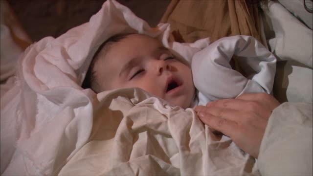 cu zi zo view of mother with baby boy / tuscany, italy   - キリスト降誕点の映像素材/bロール