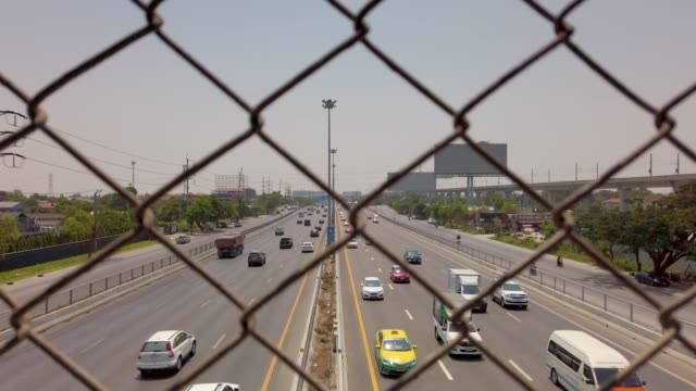 view of motorway behind fence - wire mesh fence stock videos & royalty-free footage