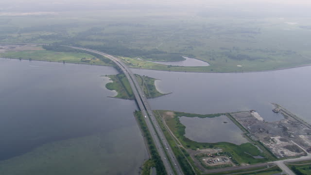 WS AERIAL View of Motorway over to island of Amager / Copenhagen, Denmark