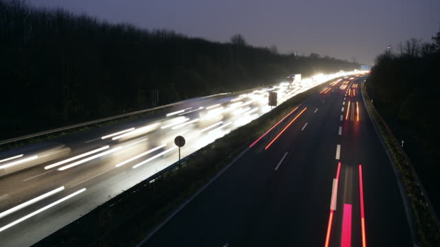 WS T/L View of motorway with heavy traffic at dusk /Cologne, North Rhine-Westphalia, Germany