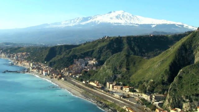 View of Mount Etna and the coast, Sicily Italy.