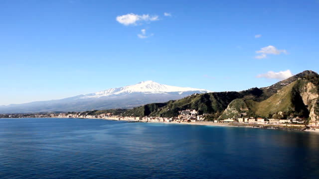 View of Mount Etna from Taormina, Sicily Italy.