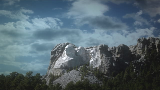 WS T/L View of mount rushmore national memorial and clouds moving on / South Dakota, United States