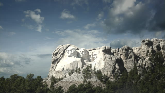 WS View of mount rushmore national memorial and clouds moving on / South Dakota, United States