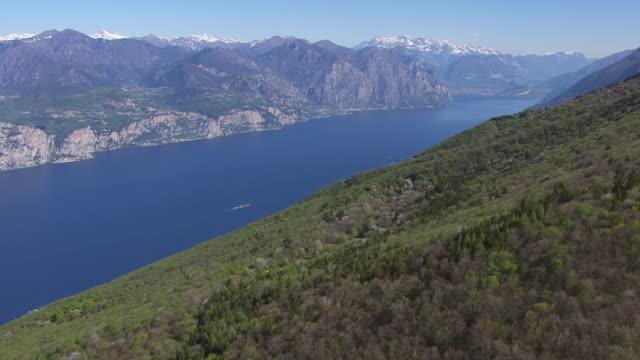 WS AERIAL View of mountain and lake / Lake Garda, Trentino, Verona, Brescia