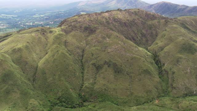 ws aerial view of mountain / minas gerais, brazil - minas stock videos and b-roll footage
