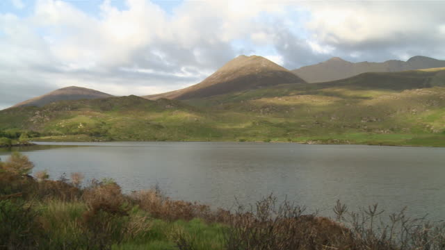 ws pan view of  mountain near river / glenbeigh, county kerry, ireland - record breaking stock videos & royalty-free footage