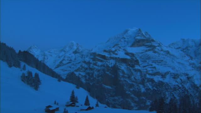 ws pan view of mountain peak in winter / gimmelwald, berner oberland, switzerland - gimmelwald stock videos & royalty-free footage
