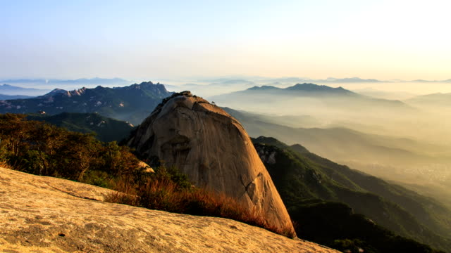 view of mountain peaks (called by insubong, bakwundea, and mangyeongdae) and cloudsea at mt. bukhansan national park (the most popular mountain in seoul) - naturwunder stock-videos und b-roll-filmmaterial