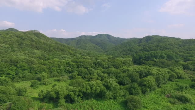 vidéos et rushes de view of mountain range and blue sky in dmz (demilitarized zone, a strip of land running across the korean peninsula), south korea - land