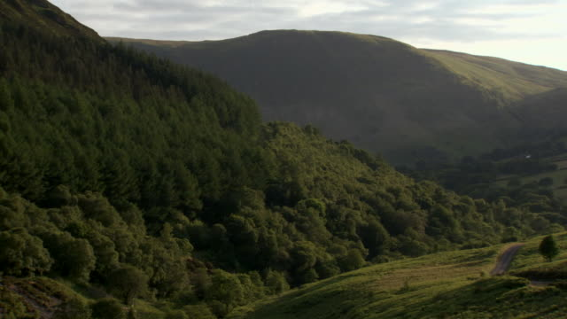 ws pan view of mountain / rhayader, powys, wales  - powys stock videos & royalty-free footage