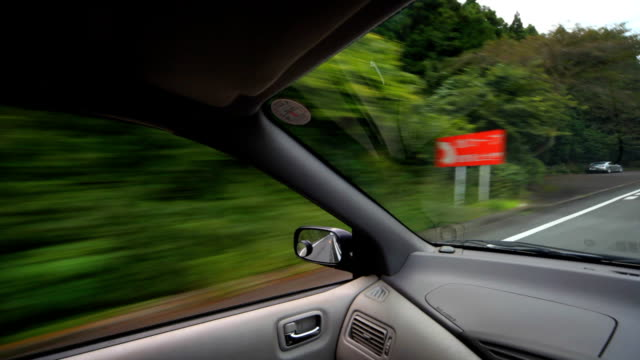 view of mountain road from passenger seat. - plusphoto stock videos & royalty-free footage