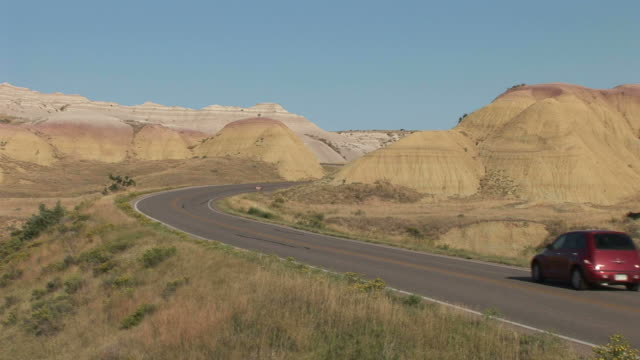 view of mountain road in badlands national park united states - badlands stock videos & royalty-free footage