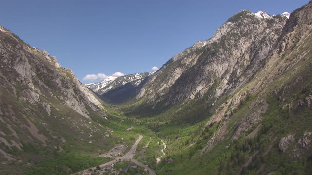 WS AERIAL View of mountain valley over little cottonwood road / Utah, United States