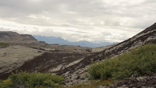 ms td view of mountain valley under sky / reykjavik, hofudhborgarsvaedhi, iceland  - wiese video stock e b–roll