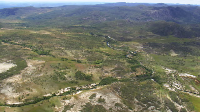 ws aerial view of mountain with river / minas gerais, brazil - minas stock videos and b-roll footage
