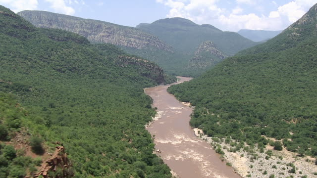 WS AERIAL View of mountainous terrain and flowing river / Polokwane, North West Province, South Africa