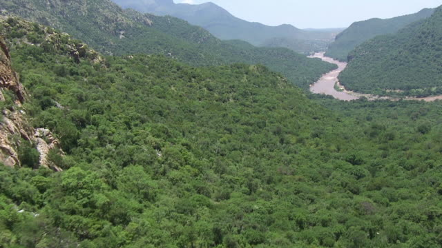 WS AERIAL View of mountainous terrain with river / Polokwane, North West Province, South Africa