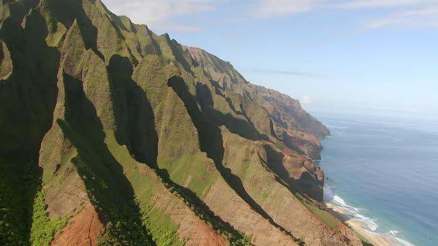 WS AERIAL View of mountains along napali coast on island of Kauai / Hawaii, United States